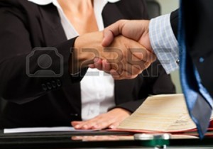 11193687-mature-female-lawyer-or-notary-with-client-in-her-office--handshake
